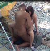 The guy shoot on camera as a young couple having sex on the beach